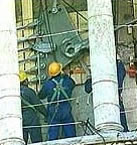 Construction workers on the tower of Pisa